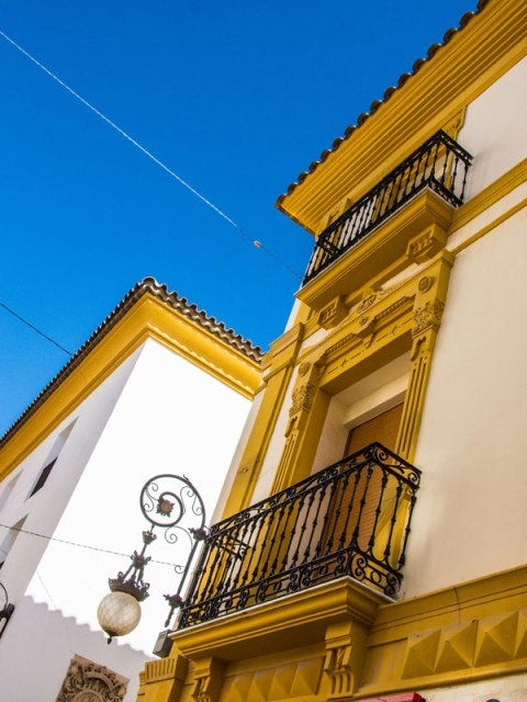 Classic Bright White and Yellow Buildings in Lorca, Spain.